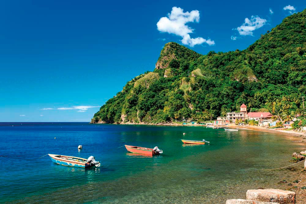 Boats at anchor in tranquil Soufrière Bay. Photo by Loneroc/Shutterstock.com