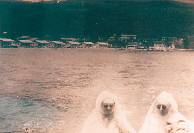 Sister Marie Benedict, right, died in Trinidad in 1994; Sister Agnes, left, died in 1998 in Guadeloupe. The settlement at Cocos Bay for male patients can be seen in the background. Photograph by Catherine Gillo