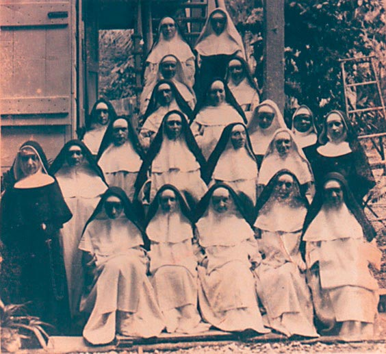 Group of Dominican Sisters at the Cocorite leprosarium, 1920·22. Front row, second from left, is Sister Marie Purification Chatelaine, the first nun to die at Chacachacare. Photograph by Catherine Gillo