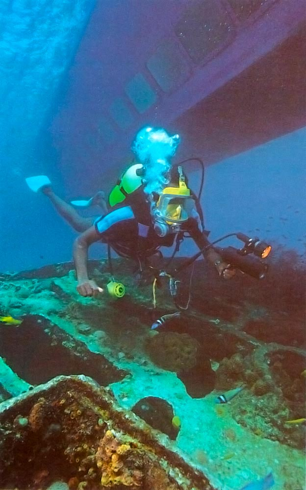 Diver with video camera swims over the Berwym. The Atlantis Seatrek submarine is in the background. Photograph by Mike Toy