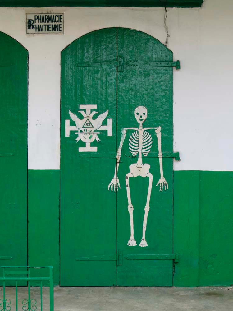 A pharmacy in Jacmel offers cures for whatever ails your bones. Photo by Nicholas Laughlin