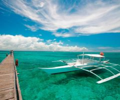 Preparing for a jaunt in an outrigger canoe off Mactan Island. Photo by pmrmichaelangelo / Shutterstock.com