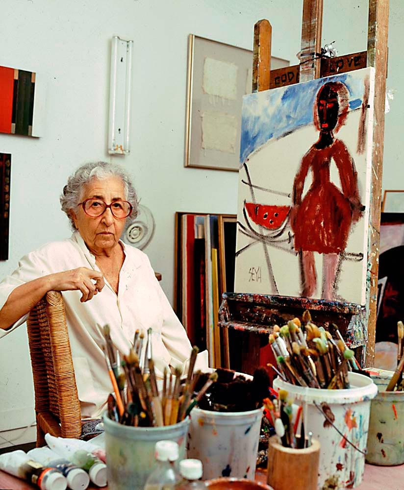 "Seya at work: ""You can't paint without touching a person that one meets in spirit"". Photograph by Franz Marzouca Photograph by Franz Marzouca"