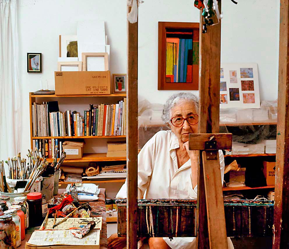 Seya in her studio. A self-taught artist, she says she relies on her mind's eye when she's painting. Photograph by Franz Marzouca