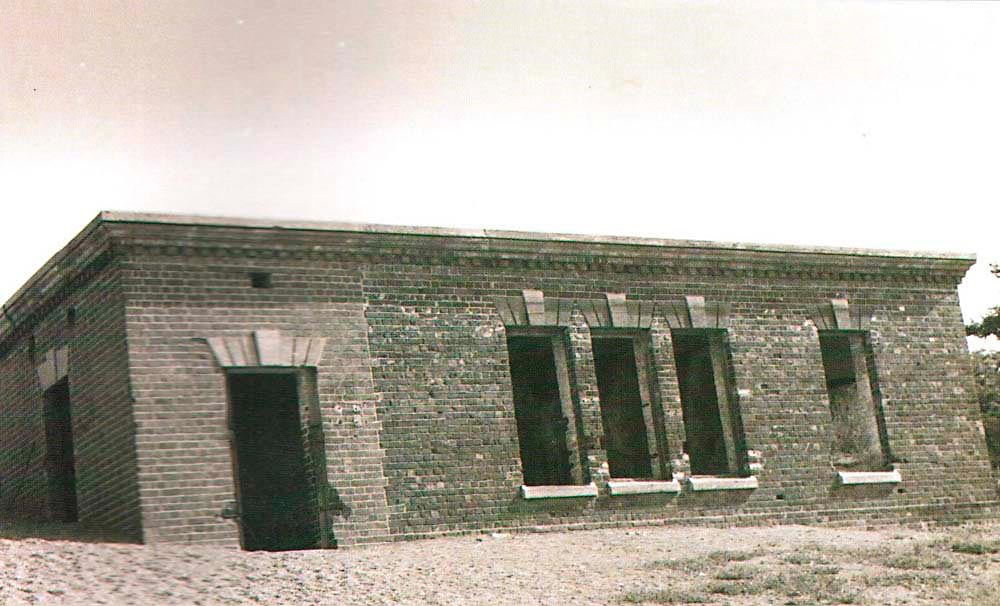 """Royal Artillery Store (popularly known as the """"Giddy House""""), built in 1888 at the same time as the Queen Victoria and Prince Albert Battery. The building was tilted during the 1907 earthquake. Photograph by Jamaica National Heritage Trust"""