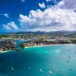 """St Lucia's Rodney Bay: """"Floating, the hills clear in their distances"""""""