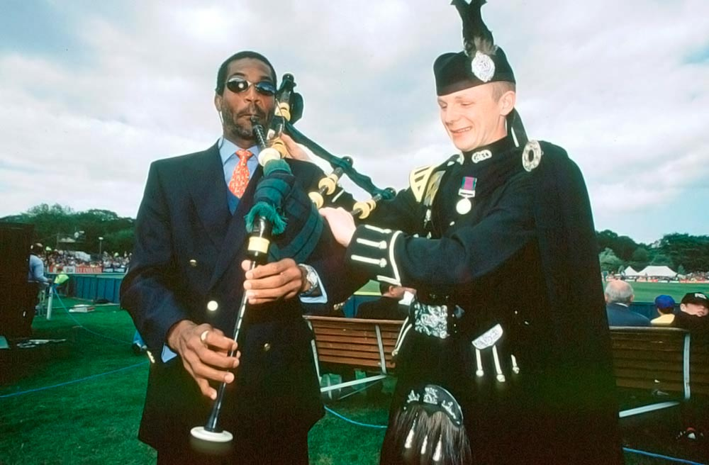 Bagpipe break: Mikey tests his musical skills at the 1999 World Cup, Edinburgh, Scotland. Photograph by Craig Prentis/Allsport