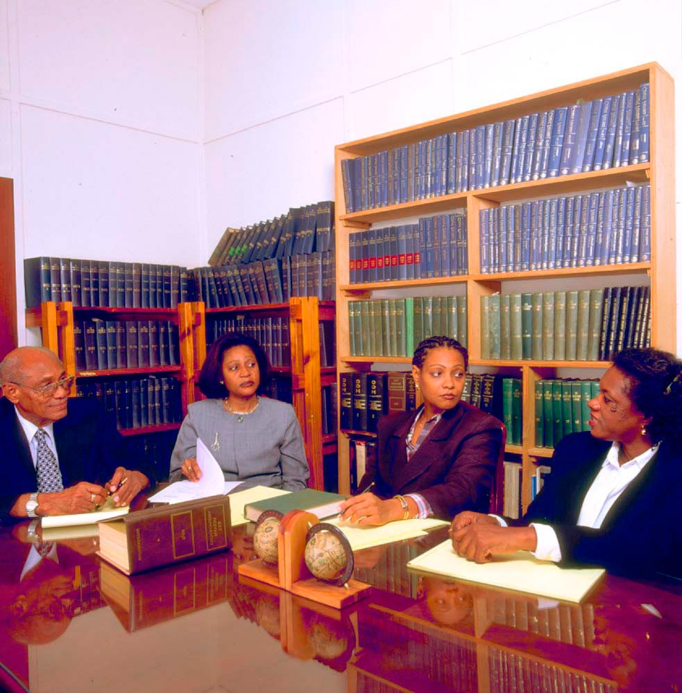 In chambers with (left to right) father Algernon W. Symmonds, Q. C., and partners Margaret Reifer and Margot Greene. Photo by Mike Toy