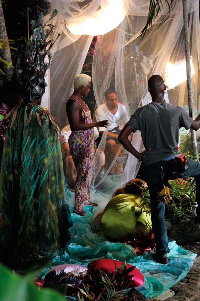 Actor Adrian Green (Oberon) on set with Shakirah Bourne, Kirk Dawson (gaffer), and Adam Worrell (digital imaging technician). Photo by Neil Marshall, courtesy A Caribbean Dream