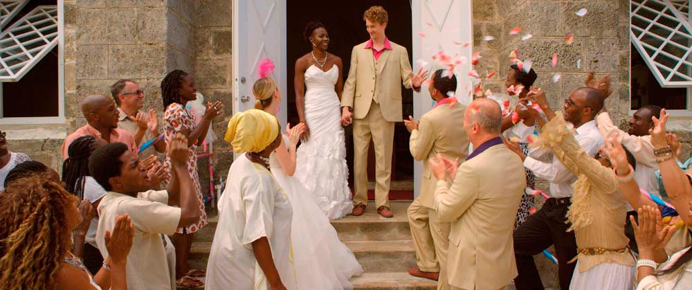 Young lovers Helena (Keshia Pope) and Demetrius (Sam Gillett) in A Caribbean DreamÕs wedding scene, filmed at St AndrewÕs Parish Church. Photo by Neil Marshall, courtesy A Caribbean Dream