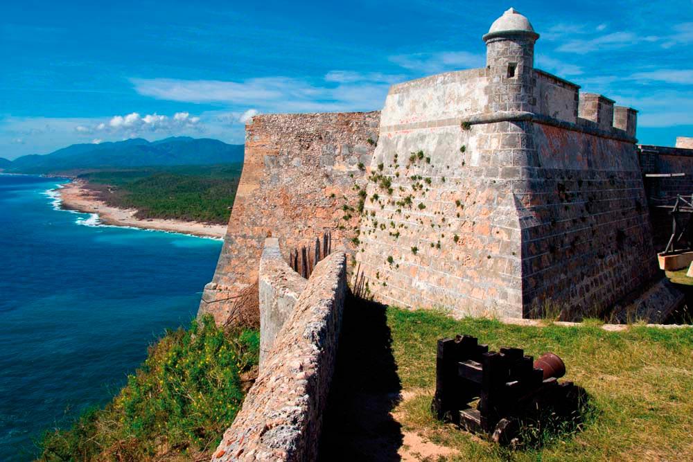 The Castillo de San Pedro de la Roca once protected the city of Santiago de Cuba from sea invasion. Photo by Shutterstock.com/Corlaffra