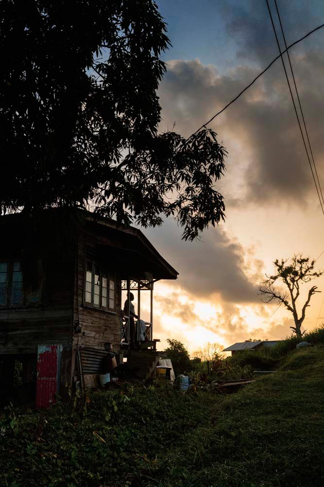 The sun rises over a house at Fifth Company, one of the Merikin villages of south Trinidad. Photo by Marlon Rouse