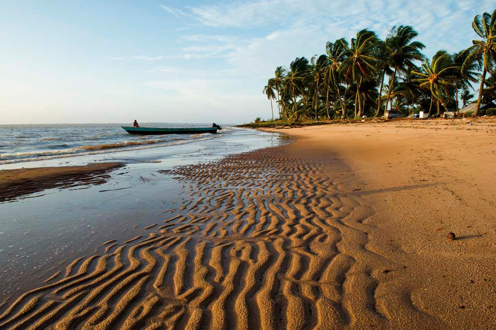 It could be a beach anywhere in the Caribbean — but in this case it's Galibi, near the mouth of the Marowijne River on Suriname's Atlantic coast. Photo by Ariadne Van Zandbergen