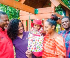 Noel and Chevaughn Joseph (at left) with a Grenadian family helped by the Just Because Foundation: baby Shemmia with her parents Alisha and Shem. Photo by Warren Le Platte