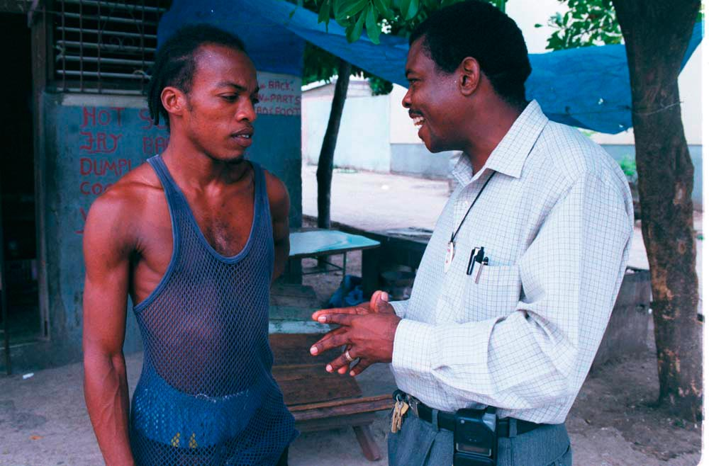 Bobby Wilmott and a young Trench Town resident. Photograph by Wayne Tippetts