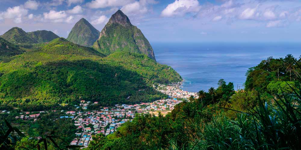 Quiet Soufrière occupies a gentle valley near the towering Pitons. Photo by Alan Copson/Photographer's Choice RF/Getty Images