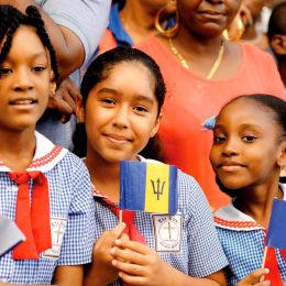 Enjoying the spectacle at the Barbados 50th Anniversary of Independence launch parade. Photo by Barbados Tourism Marketing Inc