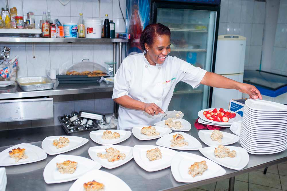 Chef LaCrette in her natural environment, the kitchen. Photo by Damion C. Jacob, DCJ photography