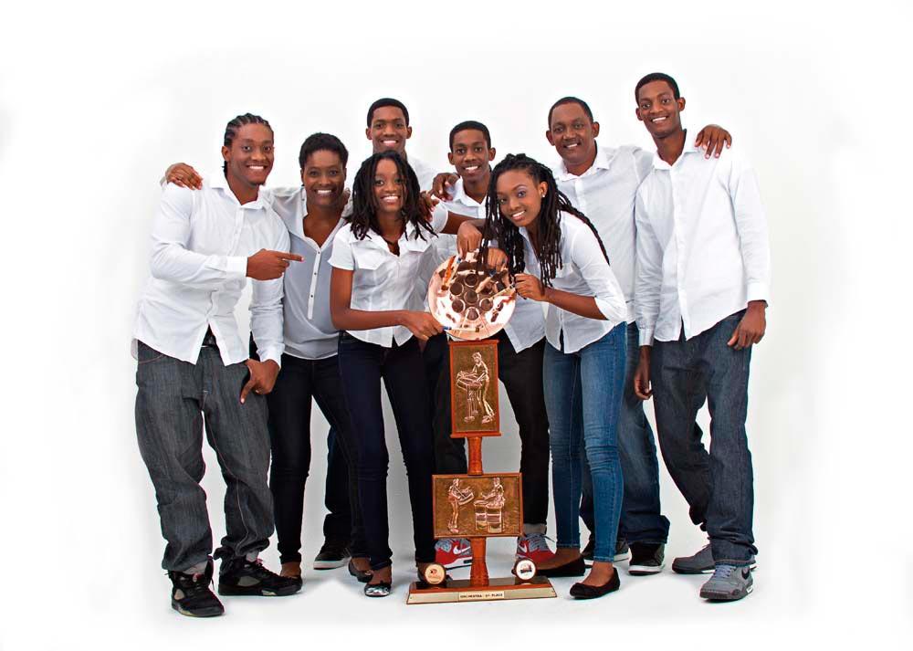 The talented Codringtons: from left, Kareem, Karen (mother) Kizzi, Khari, Kamau, Keisha, Cary (father), and Kaijah. Photo courtesy Codrington Family