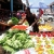 A vegetable vendor plies his trade outside the market on the crowded Chaguanas Main Road. . . . Photo by Andrea De Silva
