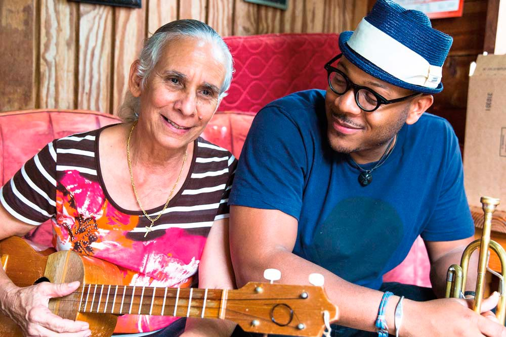 Etienne Charles with parang legend Clarita Rivas at her home in St Joseph, Trinidad. Photo by Maria Nunes