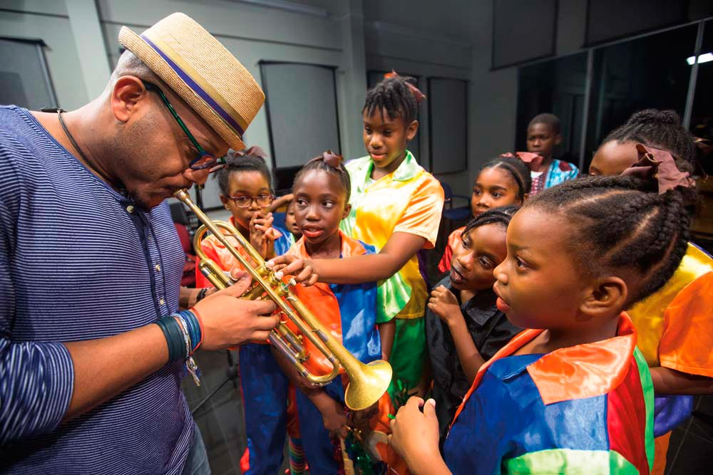 With young members of the Speechettes Tobago speech band. Photo by Maria Nunes