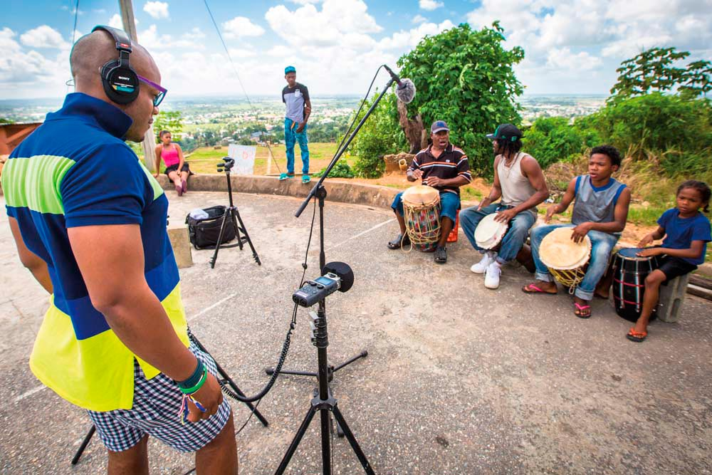 Field recording in Arouca, Trinidad, with kalinda drummers Desmond Noel, his son Peter, and his grandson in January 2016, during research for Carnival: The Sound of a People. Photo by Maria Nunes