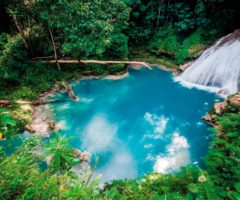 In the hills above Ocho Rios, the Blue Hole — also sometimes called Secret Falls — are a turquoise oasis set among a profusion of trees and flowers. Photo by Ivan Kokoulin/Shutterstock.com
