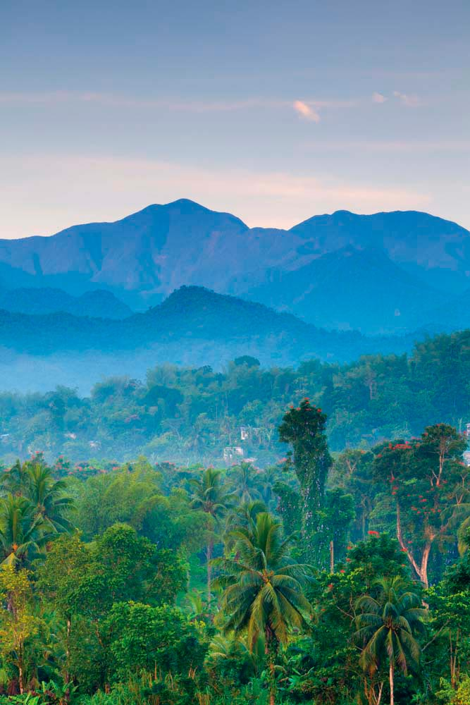 Up close, the Blue Mountains of western Jamaica are lush and green — but from a distance, their mists and hazes lend the hills the indigo shades that give the range its name. Photo by Doug Pearson/AWL/Getty