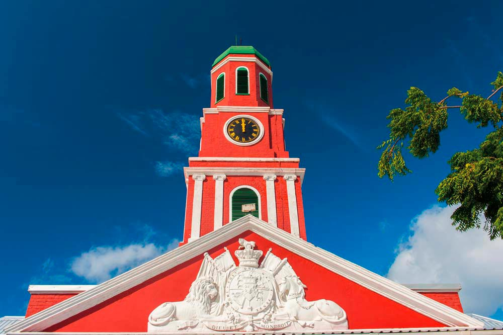 The bold red clocktower overlooking the Garrison Savannah, on the outskirts of Bridgetown, is both a historic site and a landmark. Photo by Filip Fuxa/Shutterstock.com