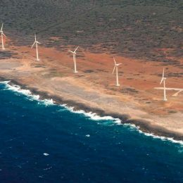 Wind turbines on the coast of Aruba contribute to a goal of one hundred per cent renewable energy 