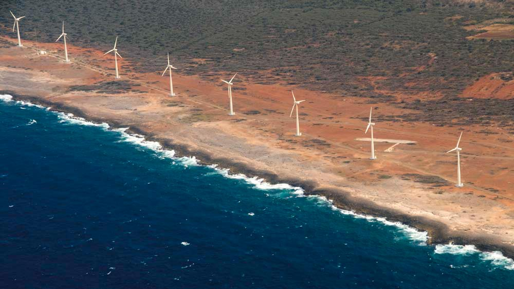 Wind turbines on the coast of Aruba contribute to a goal of one hundred per cent renewable energy by 2020. Photo by iStock.com/hairballusa