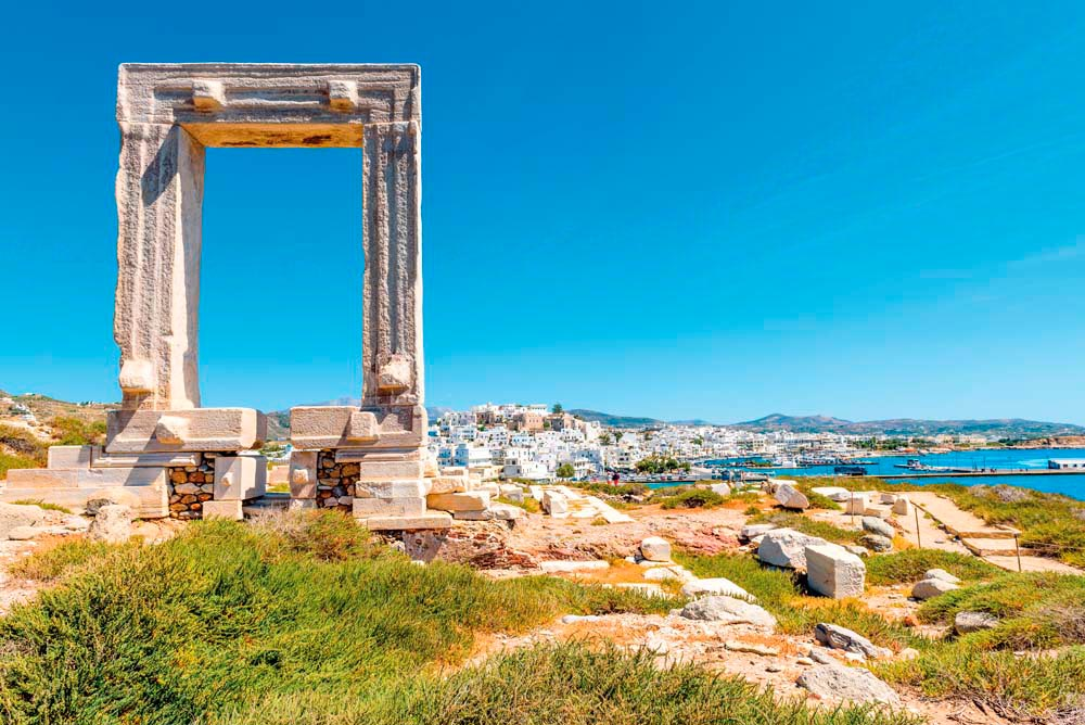 The Portara, what remains of a 2,500-year-old temple, towers above the main town on Naxos. Vivooo/Shutterstock.com