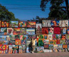 1. Paintings by Baptiste Jonas on display in Port-au-Prince. Photo by Hemis / Alamy Stock Photo