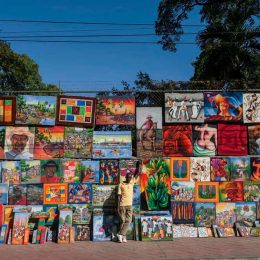 1. Paintings by Baptiste Jonas on display in Port-au-Prince. Photo by Hemis / Alamy Stock Photo