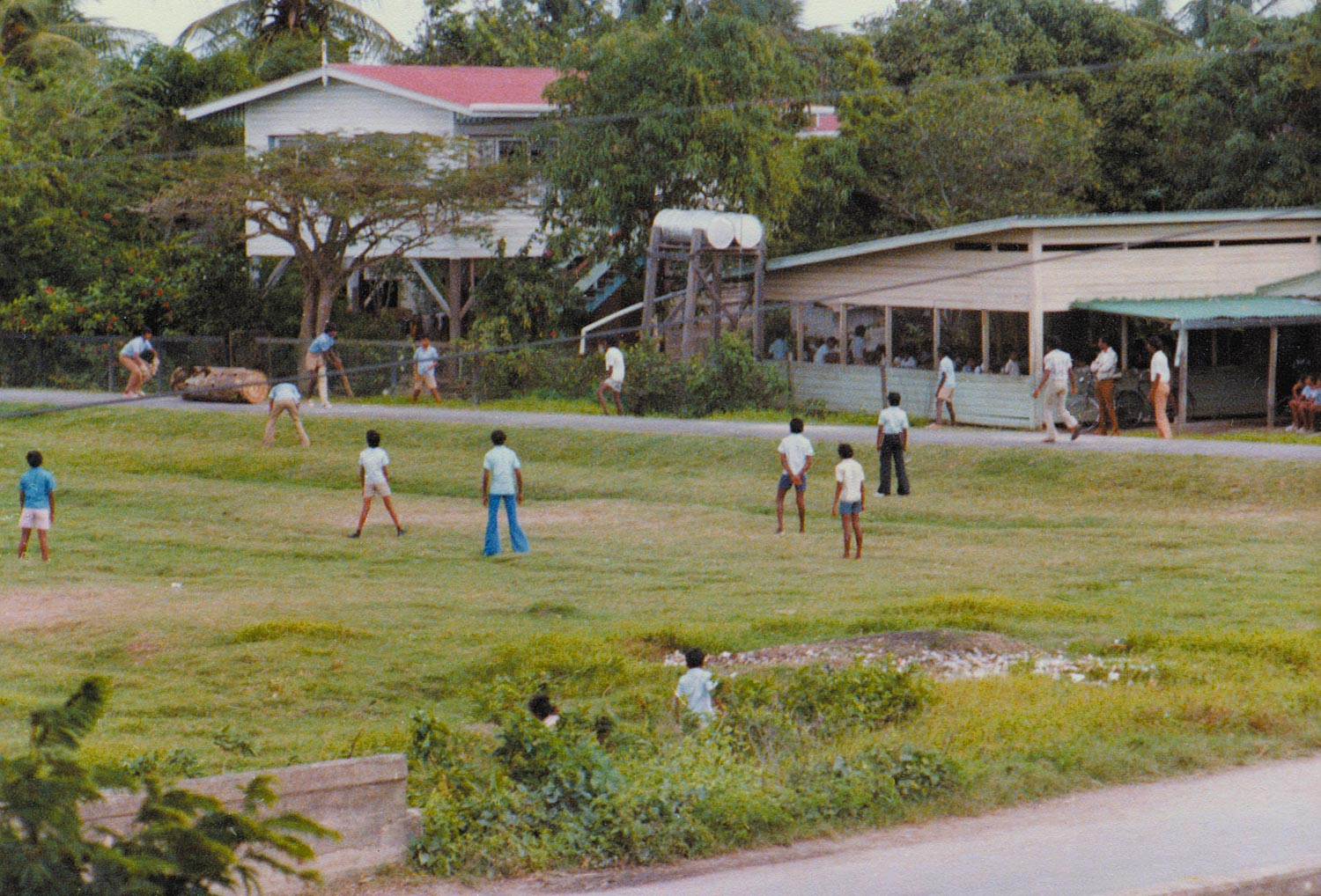 School boys playing cricket in Guyana in the 1960s. Photograph by Chico Khan