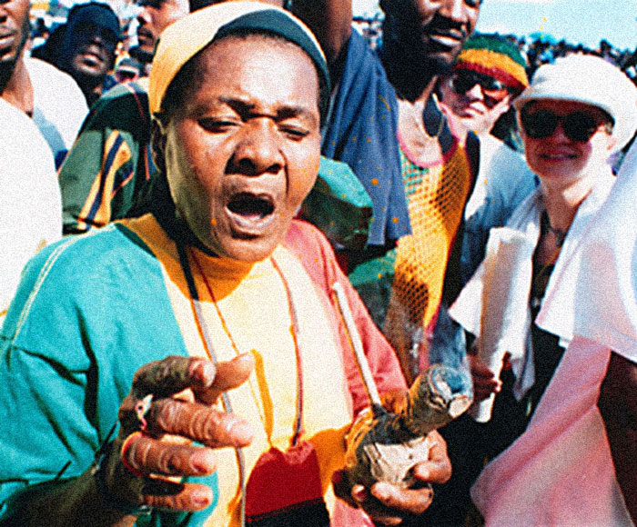 Peter Tosh sang Legalise It and this woman demonstrated with her chillum pipe, on behalf of the holy herb in Kingston, Jamaica. Photograph by Michael Gordon
