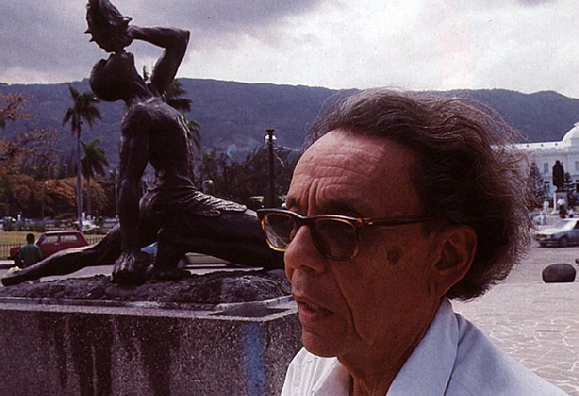 Haitian sculptor Albert Mangones with his famous work Le Marron Negre in Port-au-Prince