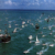 Replicas of Columbus' three ships arrive in Miami escorted by hundreds of welcoming vessels