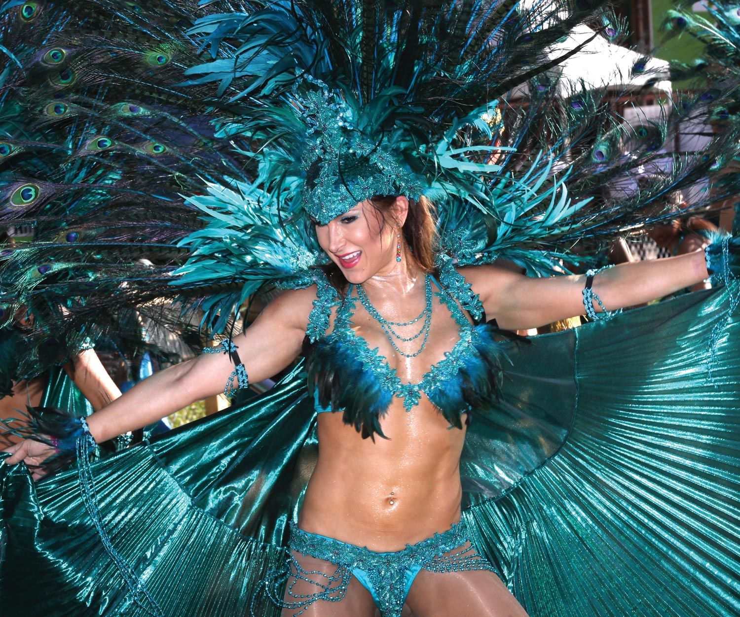 A masquerader 'making a joyful sound and jumping up in the air'. Photograph by Andre Alexander