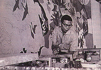 Chang working on Scarlet Ibis mural for the Trinidad Hilton Hotel. Photograph by Noel Norton
