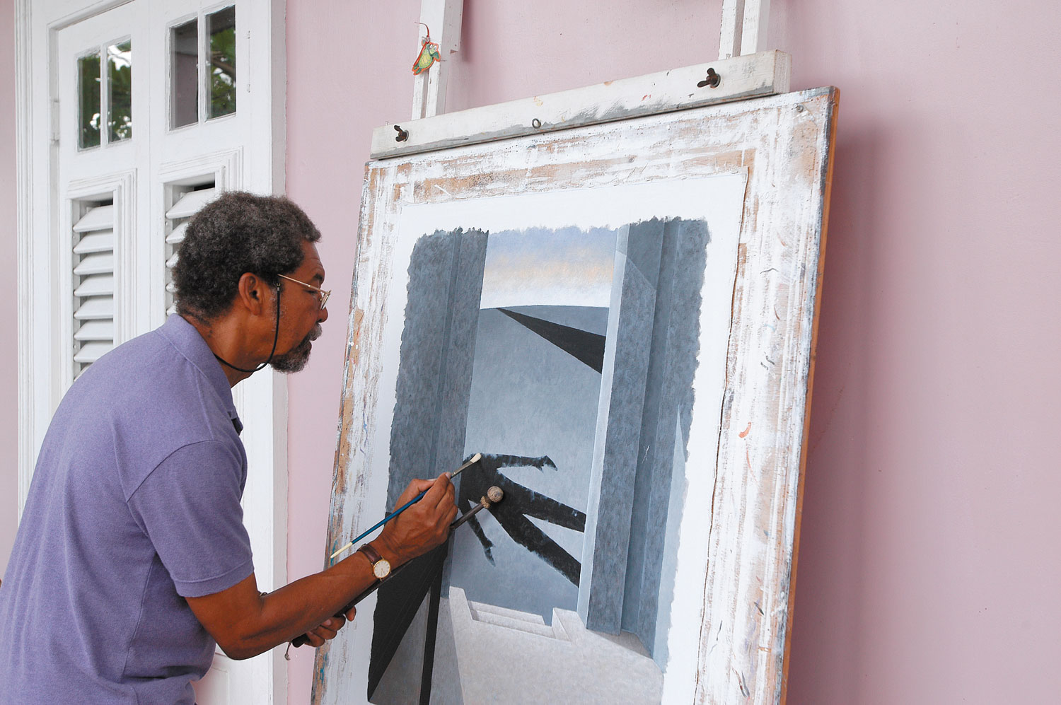 Stanley Greaves working at his house in Barbados. Photograph by Mike Toy