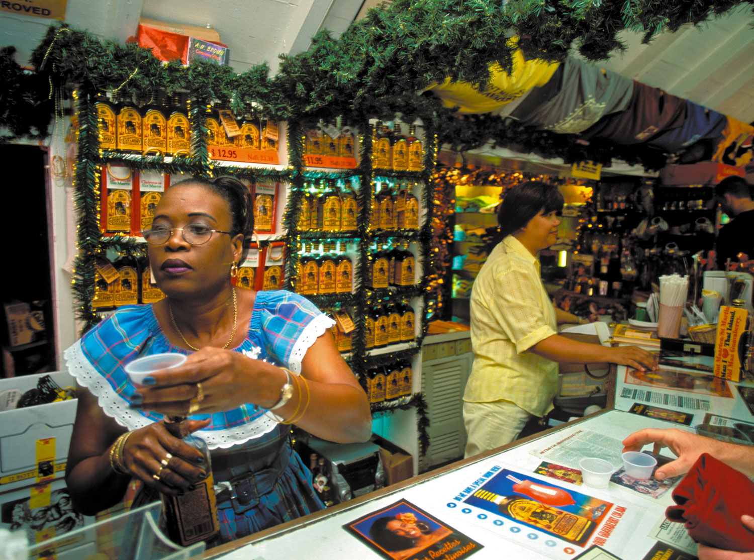 Customers sample the goods at the Guavaberry Shop on Philipsburg's Front Street. Photograph by Donald Nausbaum