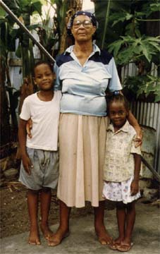 Kincaid's mother, Annie Richardson Drew, with two young reatives in Antigua in the mid 1980s. Photograph by Kenneth Ramchand