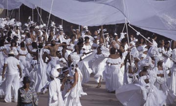 In 1983's River, the River People dance beneath their pure white canopy. Photograph by Jeffrey Chock