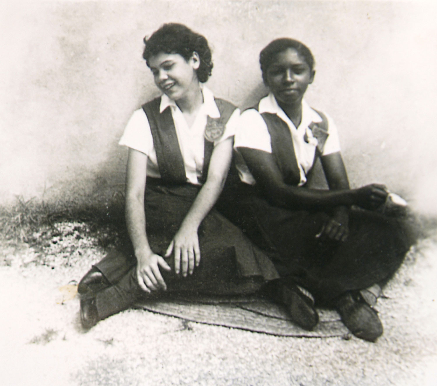Senior in her high school uniform with a friend. Photograph courtesy Olive Senior