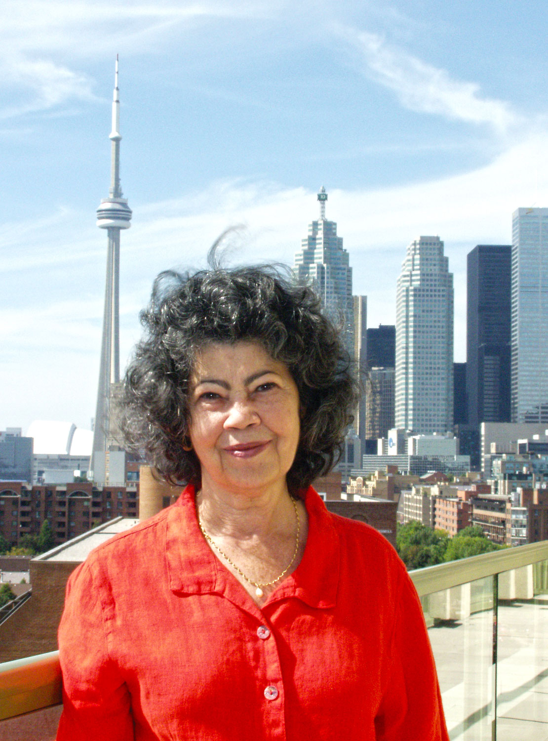 Senior on the balcony of her apartment in Toronto. Photograph by Martin Mordecai