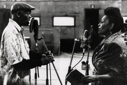 Ibrahim Ferrer recording a duet with Omara Portuondo. Photograph by Donata Wenders/Courtesy