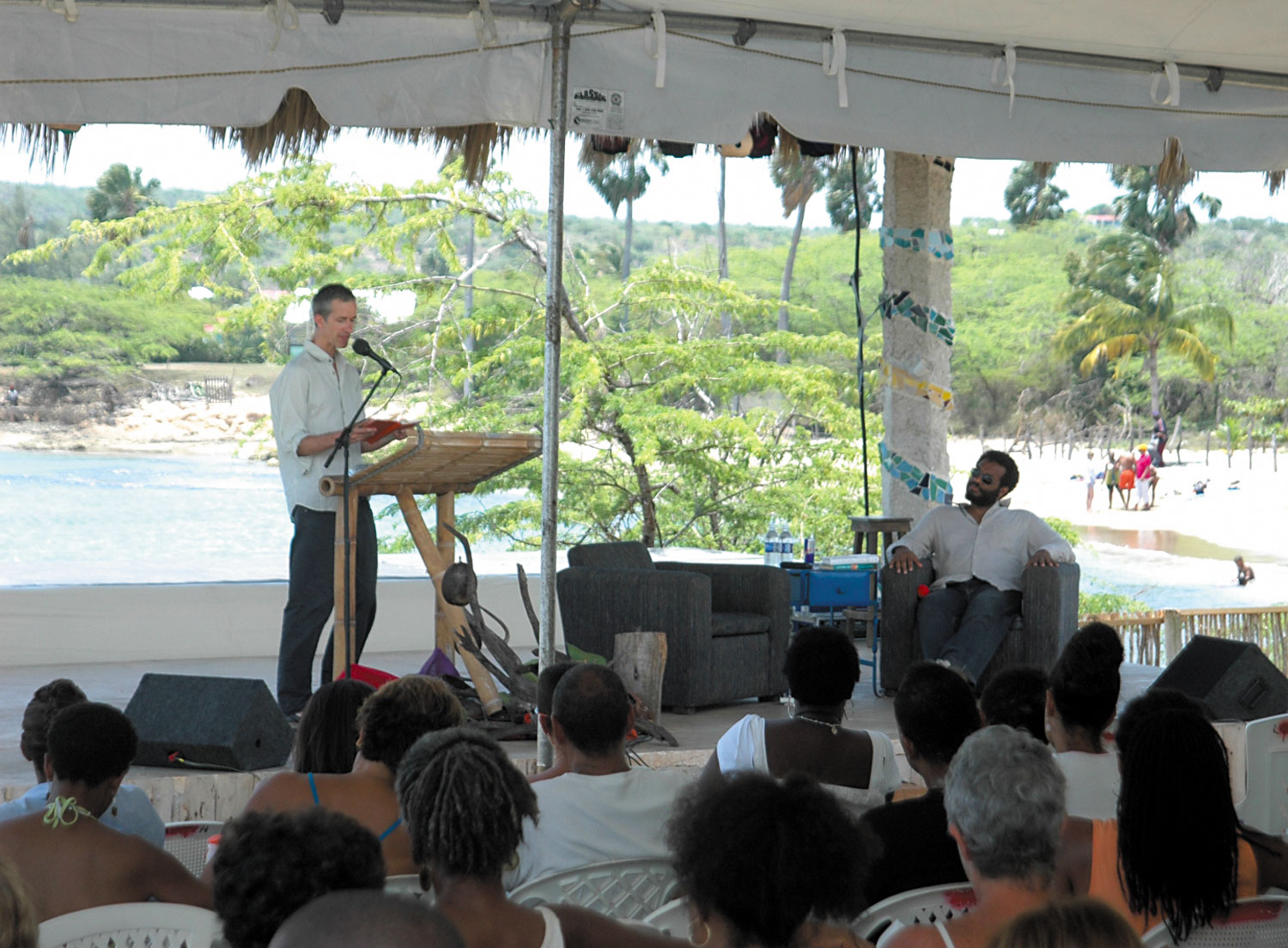British author Geoff Dyer reads at Calabash 2006 as Colin Channer, founder and artistic director of Calabash, listens. Photograph courtesy the Calabash International Literary Festival