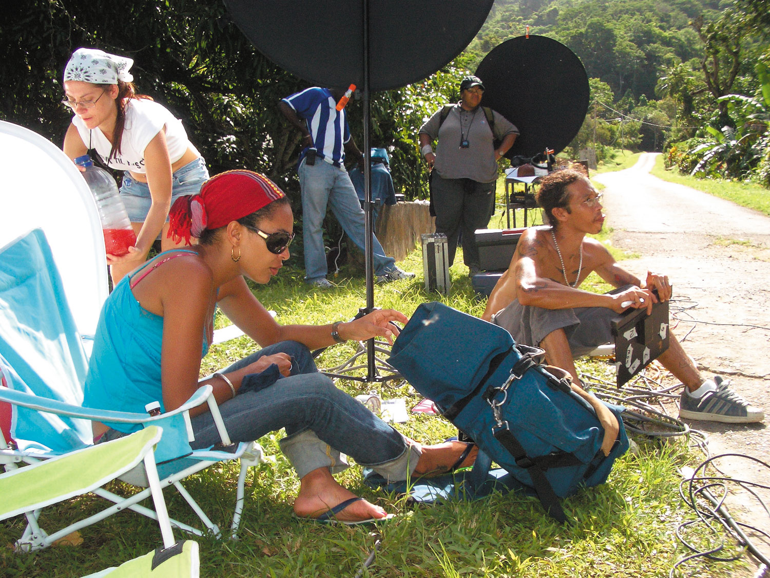 Joebell and America director Asha Lovelace (front left) with crew members, on location in Lopinot. Photograph by Georgia Popplewell